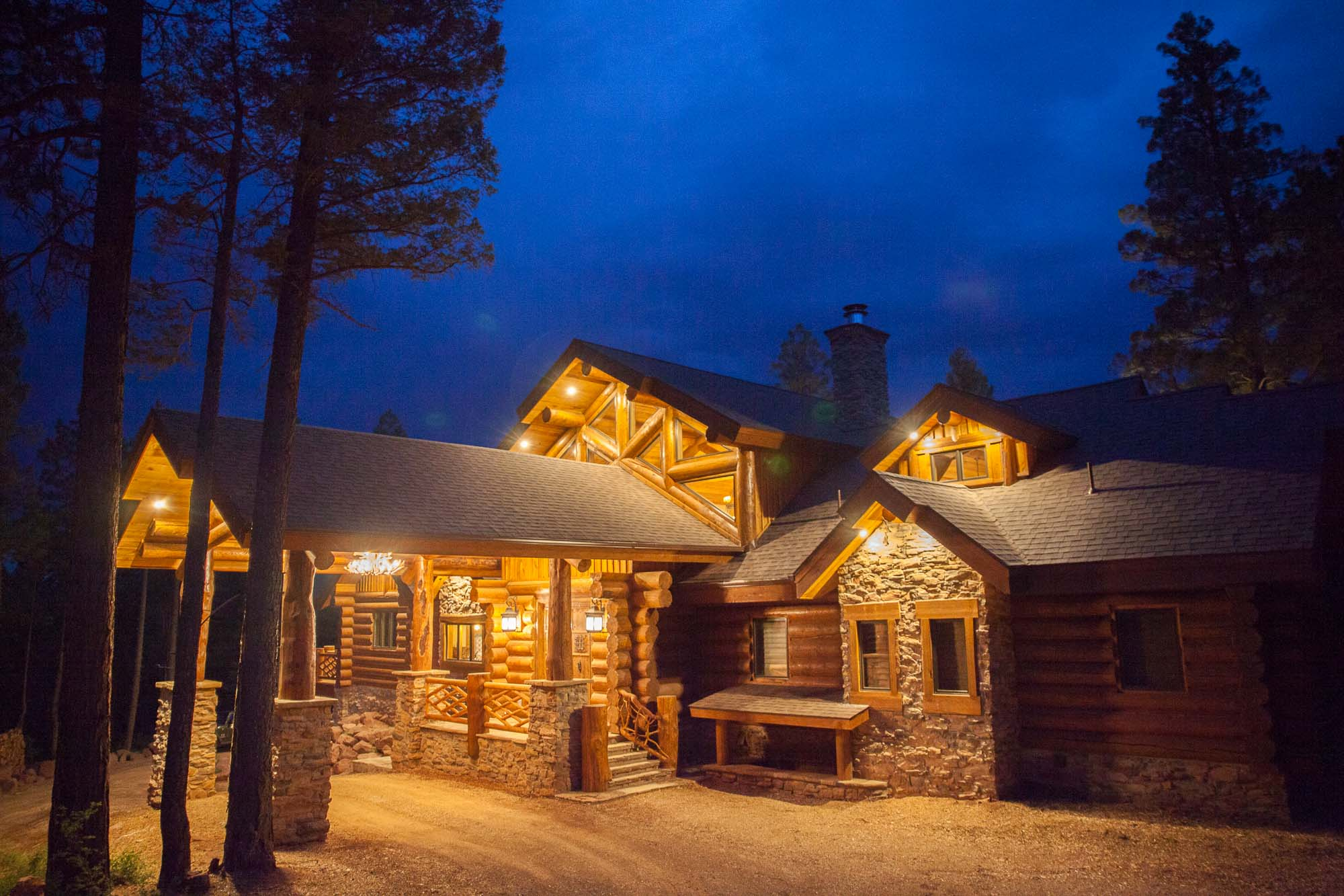 night photo of the custom designed log cabin in angel fire, New Mexico
