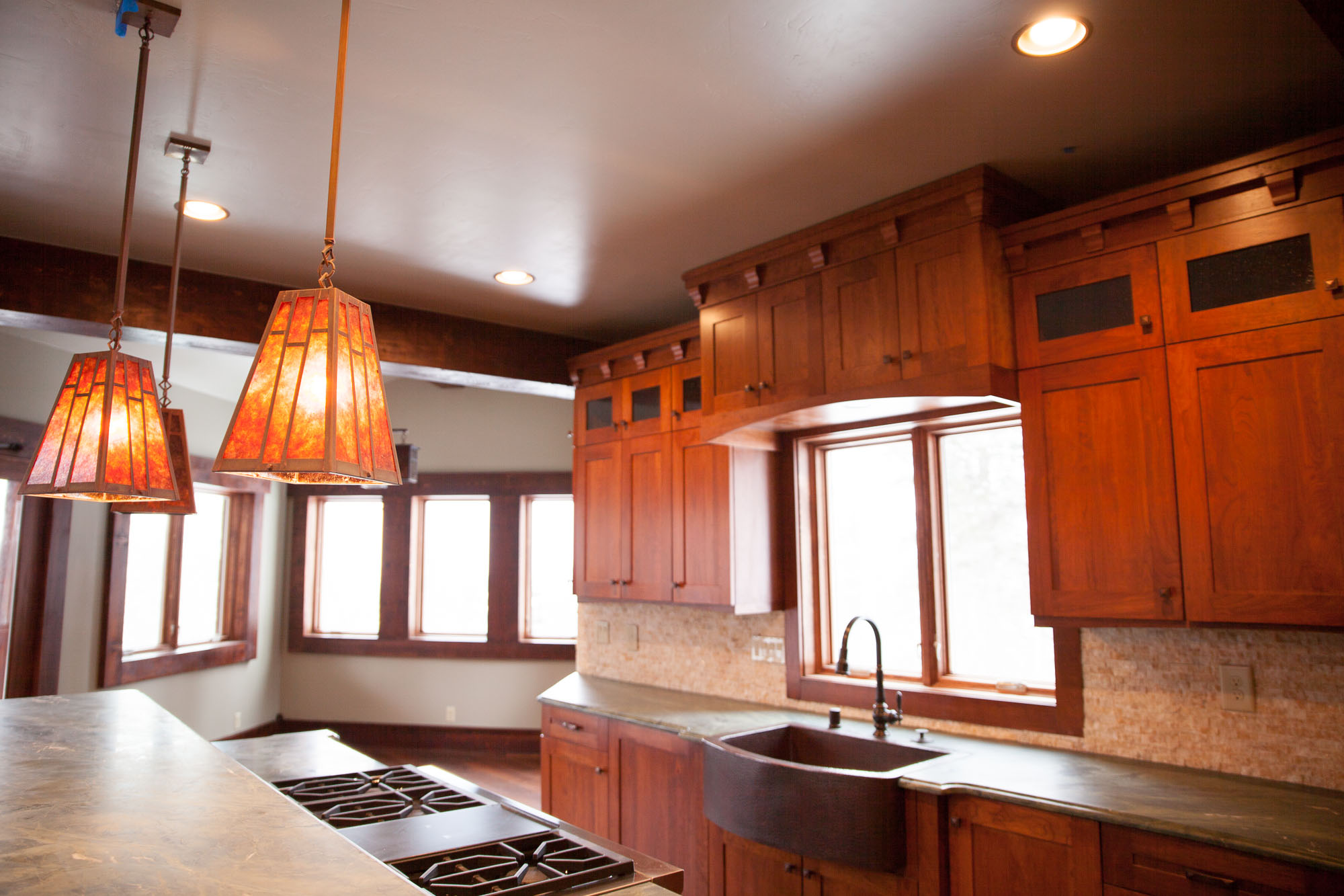 Custom Arts & Crafts style cabinets, granite kitchen counters, amber mica light fixtures.