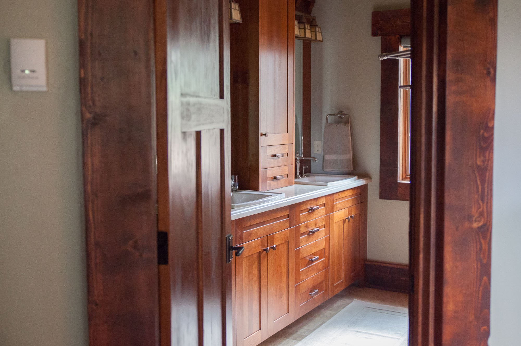 craftsman bathroom with built-in cabinetry