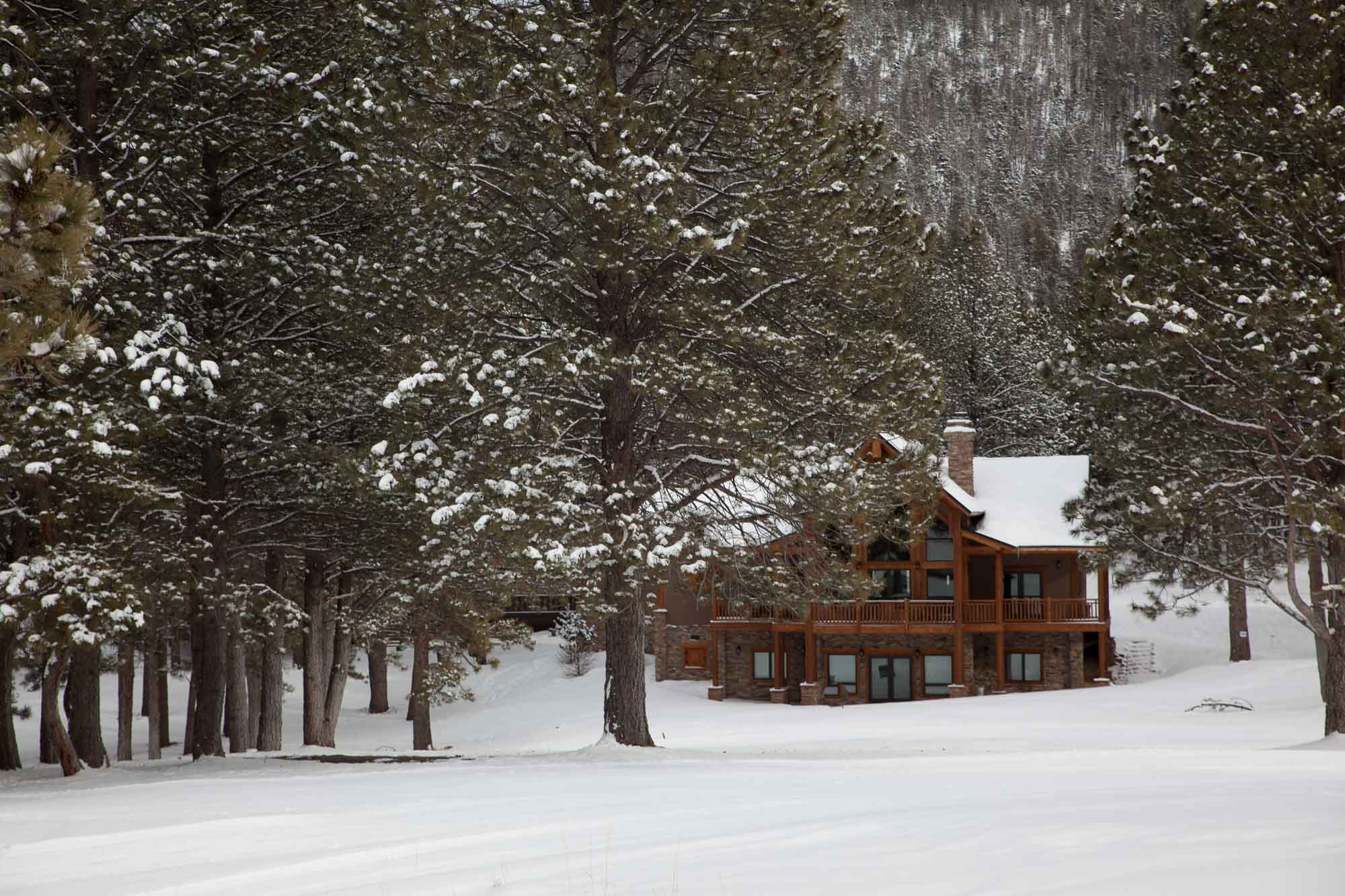 snowy log cabin in the sangre de cristos