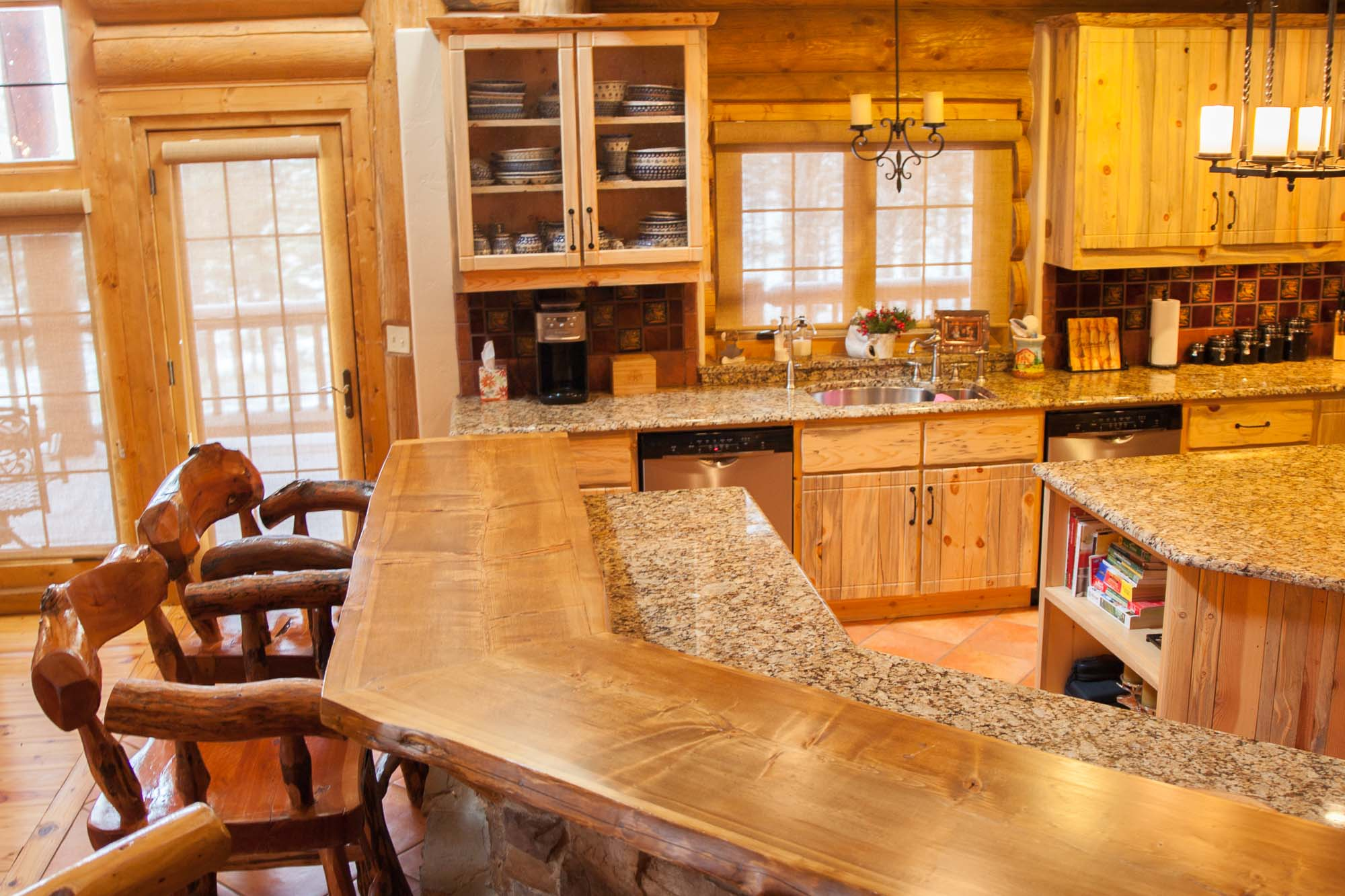Granite Counter Tops. Custom designed & built log home kitchen in Northern New Mexico by Mammoth Mill & Construction